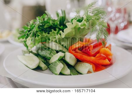 beautifully designed wedding salad on a round platter
