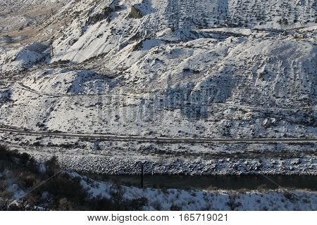 Train tracks and highway along the river - winter scenic
