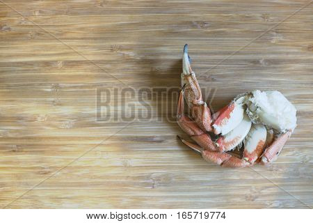 Top view of Crab legs seafood on wood background, Empty space for text