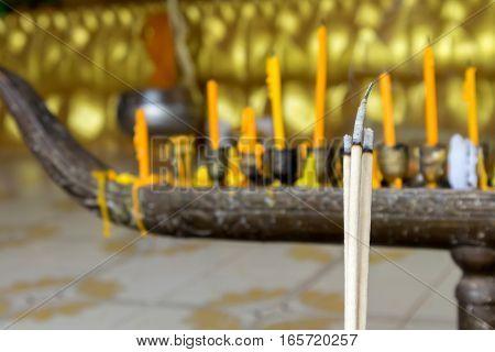 Closeup incense sticks(joss sticks) burning in the temple