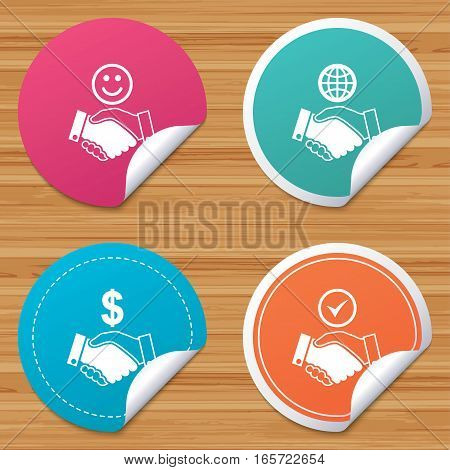 Round stickers or website banners. Handshake icons. World, Smile happy face and house building symbol. Dollar cash money. Amicable agreement. Circle badges with bended corner. Vector