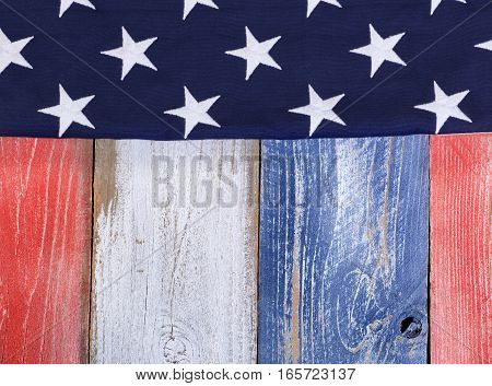 Stars on rustic painted boards in national colors of United States of America.