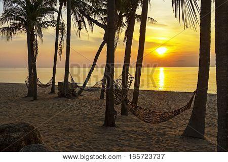 Cradle and sunrise at Ban Krut Beach Prachuap Khirikhun Province Thailand