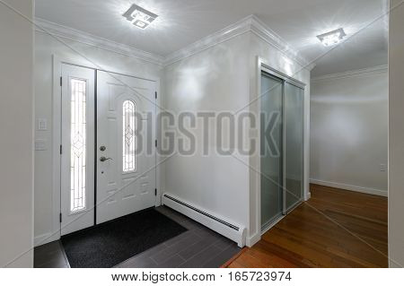 Front door with entrance hall of a house. Interior design.