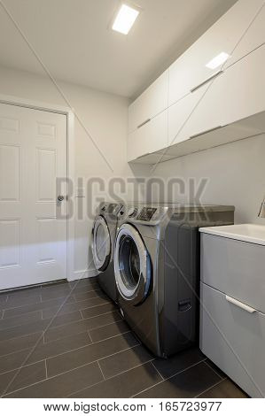 Modern laundry room with washer and dryer. Interior design.