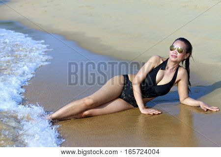 Lady show sexy swimsuit in Ban Krut Beach at Prachuap Khirikhun Province Thailand