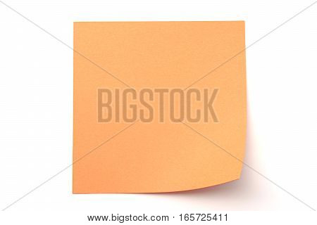 Orange paper stick note on a white background