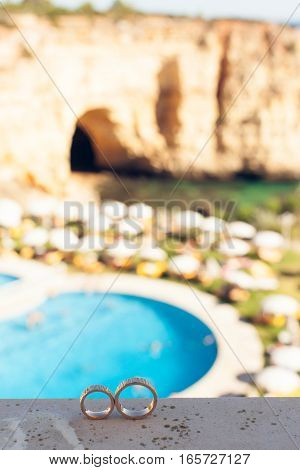 Wedding rings on a background of beautiful rocks