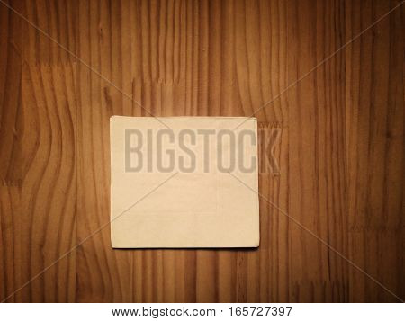 beige modern cocktail napkin on wooden table