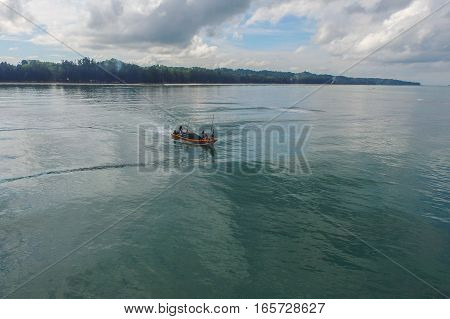Labuan,Malaysia-Jan 19,2017:Aerial view over Fishing boat on the water at Labuan island,Malaysia.Labuan local fishers provide a supply of fresh fish to the domestic village market.