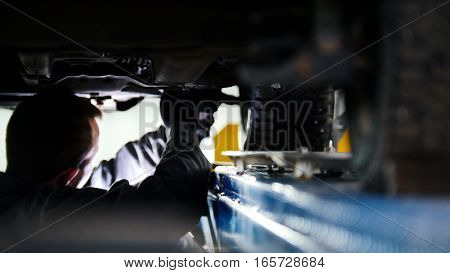 Automobile service - mechanic wrapping working device under car bottom, slider