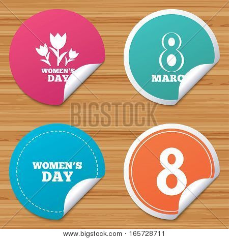 Round stickers or website banners. 8 March Women's Day icons. Tulips or rose flowers bouquet sign symbols. Circle badges with bended corner. Vector