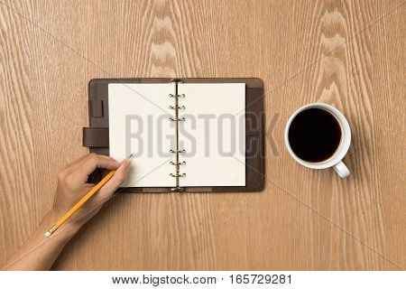 Business Planning Concept And New Year's Resolutions Concept. Top View Of Hand Writing On A Blank No
