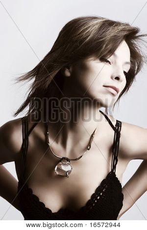 portrait of a beautiful sexy girl with necklace