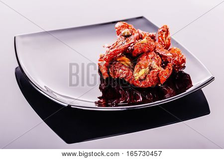 Dried Tomatoes On A Black Plate
