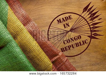 Flag of the Republic Congo on a wooden background.