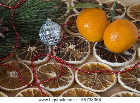 dry slices of lemon, pine twig and mandarins