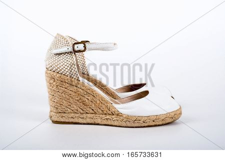 white women's sandals shoes on a white background
