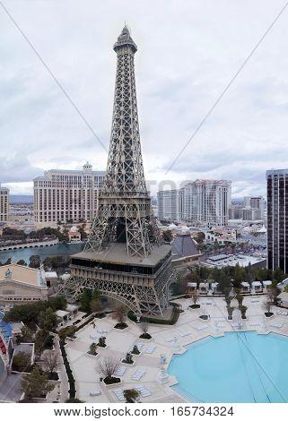 LAS VEGAS, NEVADA - DECEMBER 24, 2016: Replica Eiffel Tower and Panorama of Las Vegas - Paris Hotel window view