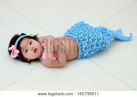baby girl with cute mermaid outfit and white background