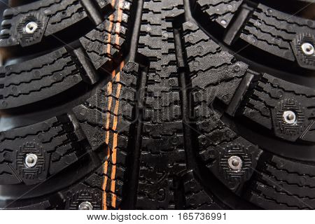 Close-up of surface of studded new winter tire