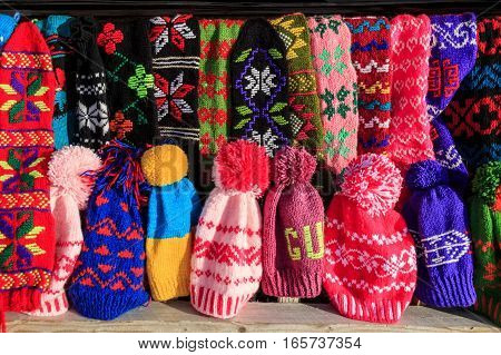 Bunch of handmade colorful ethnic styled woolen socks on the traditional fair