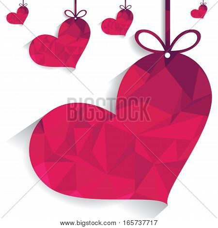 Pink heart with ribbon on white background.