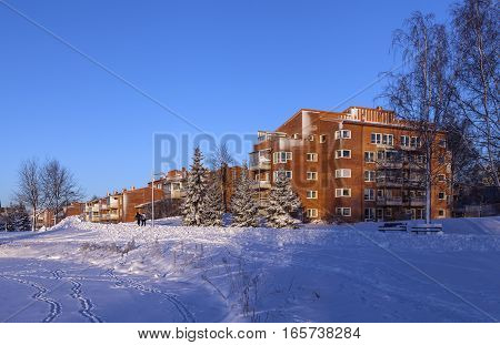 UMEA, SWEDEN ON JANUARY 16. View of a modern residential settlement, park, path, housing on January 16, 2017 in Umea, Sweden. Unidentified persons on the path. Winter. Editorial use.