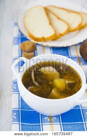 Soup Of Wild Mushrooms On A Wooden Table