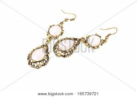Ancient style earrings isolated on a white background.