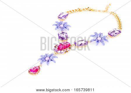 Stylish necklace with colorful stones isolated on white background.