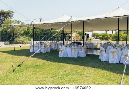 Venue for the wedding dinner under the tent