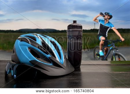 Helmet And Sunglasses Cyclist With A Road And A Cyclist Going By Bicycle