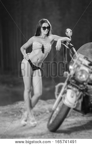 Young Beautiful Sexy Girl Standing By The Motorcycle