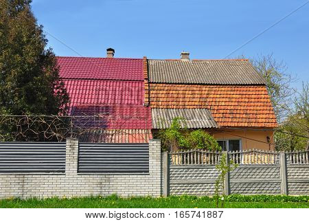 Old house is being renovated and refurbished with metal roof and ceramic tiles.