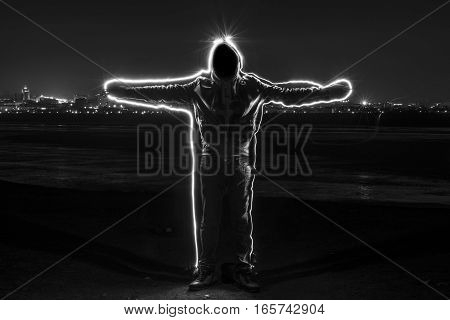 Mystic Black Hooded Man Standing In The Darkness.