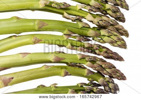 Heap of green asparagus vegetables isolated on white background close up