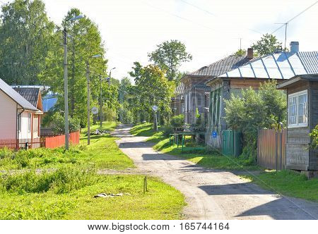 Rural street in the town of Kirillov in the Vologda region at evening Russia.