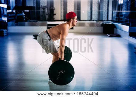 Athletic Muscular Man, Details Of Crossfitter And Fitness Trainer Working Out At Gym And Making Back
