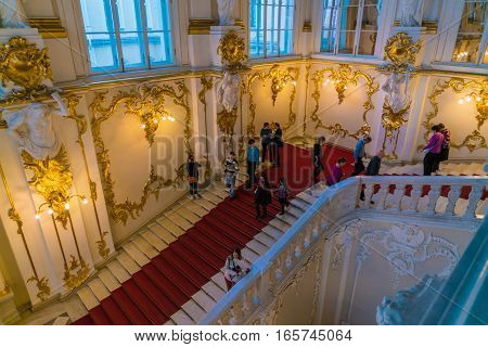 Saint Petersburg, Russia - December 25, 2016: Tourists Climbing Jordan Staircase Of Hermitage