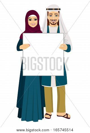 Emirati couple holding empty blank board over white background
