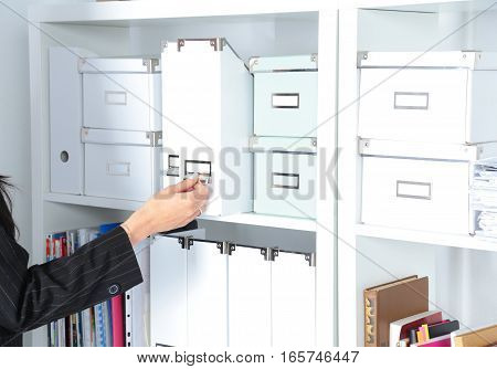 Portrait of a business woman standing in office with folder.