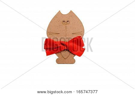 wooden cat with a red bow around his neck isolated on white background
