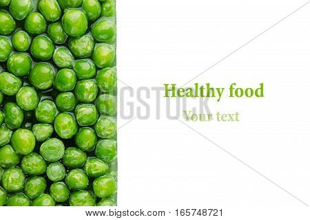 Border of wet fresh green peas in water closeup on white background. Isolated. Healthy vitamin food.