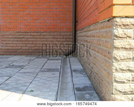 Closeup of rain gutter and sewerage system on the footpath