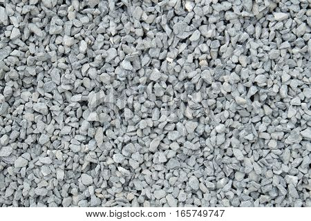 Aggregate - A stack of gray gravel / grit of coarse and loose small stones crushed at a stonepit into similar sizes.