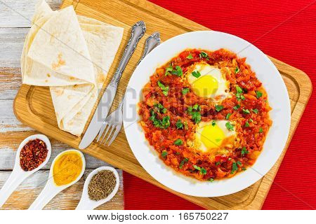 Shakshuka - Eggs,bell Pepper, Chili, Tomato Sauce And Spices