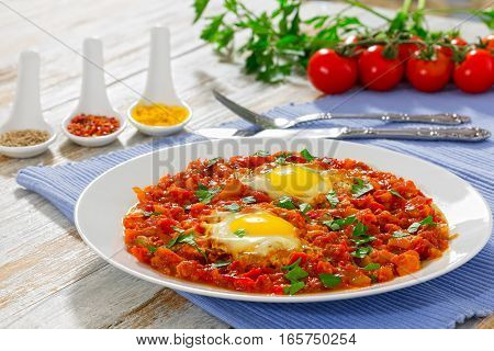 Sunny Side Up Eggs With Vegetables Sprinkled With Parsley