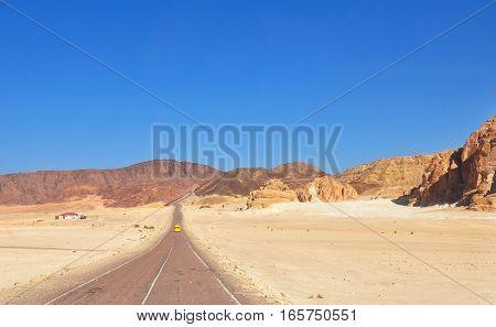 Endless Desert Road. Desert Road with mountain