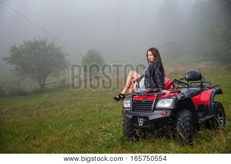 Beautiful Girl Sitting On Four-wheeler Atv